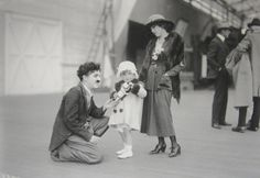 Charlie with Mary Pickford & her niece Gwynne at the Chaplin Studios.