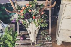 This beautiful display from Darling & Wild would look right at home at a woodland wedding; we love the use of succulents.