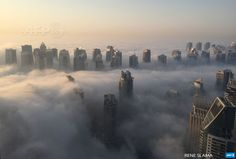 UNITED ARAB EMIRATES, Dubai : A general view shows the part of the skyline of Dubai covered in an early morning fog on October 5, 2015. AFP PHOTO / RENE SLAMA