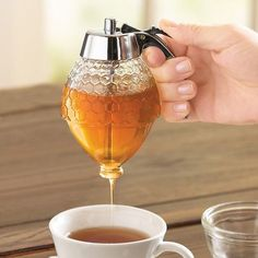 Honey dispenser is so beautiful and classy! If you're a huge honey lovers; honey dispenser is a must have. It works great for a no mess honey application. Kitchen Hacks, Kitchen Gadgets, Kitchen Tools, Diy Kitchen, Kitchen Storage, Kitchen Inventions, Cooking Gadgets, Cooking Tools, Kitchen Utensils