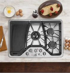 Don't worry about spills or messes anymore. Our deep-recessed GE Cafe series cooktop allows for easy cleaning.