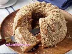 Şimdi sizlere çok kolay ve lezzetli bir kek tarifimiz var.Cevizli Kahveli Kek...Fırından mis gibi kahve ve tarçın kokuları yükselirken kekin bir an önce pişmesini sabırsızlıkla bekleyeceksiniz. Cevizli Kahveli Kek Malzemeleri: 3 yumurta 1,5 su bardağı şeker 1 su bardağı sıvıyağ veya eritilmiş margarin 3 yemek kaşığı kakao 1 yemek kaşığı tarçın 2 yemek kaşığı granül kahve 1 su bardağı iri çekilmiş ceviz 1 paket kabartma tozu 1 su bardağı su 3 su bardağı un Cevizli Kahveli Kek Yapılışı…