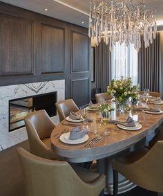 Luxurious dining room in our Chelsea project with grey oak panelling and marble fireplace