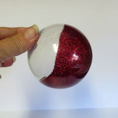 Coating the inside of an ornament with glitter