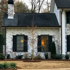 This Classico Limewash exterior home makeover is warming our imaginations on thi… - Home & DIY Exterior Paint Colors, Exterior Design, Exterior Siding, Exterior Remodel, Rustic Outdoor Decor, Black Shutters, Home Exterior Makeover, D House, House Painting