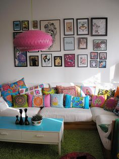 Way too many throw pillows, and a little too girly, but I love the way they've arranged the pictures