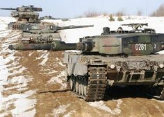 Leopard 2A4 main battle tanks from Polish Army's 10th Armoured Cavalry Brigade