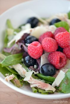 Raspberry Parmesan Chicken Salad is my favorite salad recipe! It has baby spring mix, chicken, Parmesan, olives, raspberries and raspberry vinaigrette.