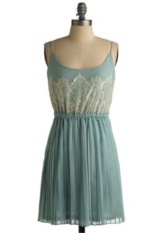 this pleated spearmint dress has a complimenting gathered waistline, and intricate floral lace which gives the piece a very delicate, girly look!