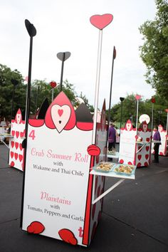 Oversize playing cards resembling the Queen of Hearts' guards from Alice in Wonderland displayed menu descriptions and served as small food stations