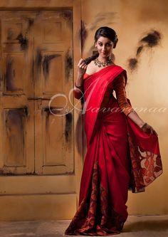Red kanchipuram silk saree with intricate cutwork on pallu&pleats.