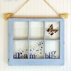 """Use an old window frame (found in antiques stores) as a frame to show off love ones. Gather pieces of chipboard the size of each pane to use as """"pages."""" Cover the chipboard with patterned paper, then add pictures and embellishments. Attach your completed chipboard """"pages"""" to the back of the window panes with a staple gun. For a finishing touch, add rub-on words or phrases to the glass panes."""