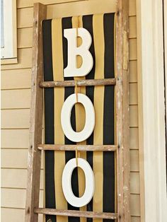 Spell out BOO with crafts store letters tied to a vintage ladder. More fall decorating ideas: http://www.midwestliving.com/homes/seasonal-decorating/fall-door-decorating/