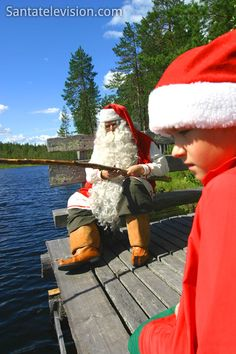Santa Claus and an elf fishing in Rovaniemi in Finland