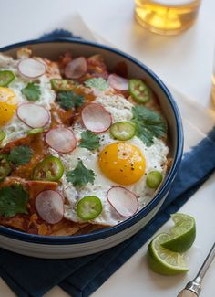 Chilaquiles is a traditional Mexican breakfast dish that is made up of a red sauce tossed with tortilla chips and cooked until softened with eggs on top! Breakfast Dishes, Eat Breakfast, Breakfast Recipes, Breakfast Ideas, Frijoles, Mets, Brunch Recipes, Mexican Food Recipes, Gourmet