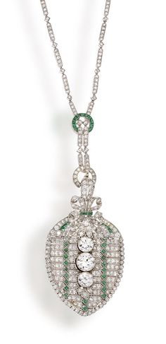 An art deco diamond and emerald pendant necklace, circa 1915 the central detachable pendant designed as a flexible shield-shaped panel set throughout with single-cut diamonds, accentuated by calibré-cut emeralds and centering three graduated old European-cut diamonds, suspended from a single-cut diamond necklace enhanced by calibré-cut emerald detail, millegrain setting