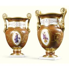 """A pair of Sèvres coral-red-ground vases """"Etrusques"""",  circa 1795,  of classical form, with twin swan and mask handles, each painted with motifs pompéiens, dans le gout de Lagrenée, with two almond shaped panels of dancing muses, connected by formal gilt scroll work on café au lait-ground, the broad neck with a band of rose trails and formal ornament, on marbled bases. One indistinctly inscribed Sèvres, R. F.  Bernard Chevalier refers in the Catalogue des porcelaines de Sèvres du château de…"""