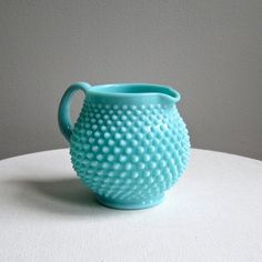 Vintage Fenton Hobnail Turquoise Milk Glass Jug Pitcher, 1950s. $98.00, via Etsy.