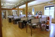I wish we had a layout like this where I work.    Ad Team Workspace by Struck Inc., via Flickr