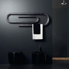 Towel warmers aren't necessarily a new invention, but this new paper-clip design by Nameeks will definitely turn some heads. The Chrome Finish makes this unique Bathroom Radiators, Interior Minimalista, Towel Warmer, Heated Towel Rail, Deco Design, Design Blog, Towel Holder, Paper Clip, House Design