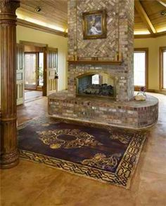 Used PermaCrete to cover the entire floor. Took inspiration from the large rectangular windows in the room to create slate-textured rectangular panels on the floor. Then used a Modello stencil to create an 8.5' by 10.5' concrete rug in front of the grand fireplace of the 600-square-foot room.