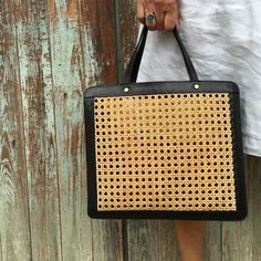 Palmgrens rattan bag in black leather. It would be perfect accessory for all the summer adventures.