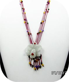 One of Etsy's carefully sheltered resellers tells a whopper of an Etsystory, attributing this new necklace to the 1930s!  These come up for sale on Ebay, sold as new, the same design in various silk cord colors.  And sell for less than $10.00.  CAVEAT EMPTOR when shopping for your Valentine!