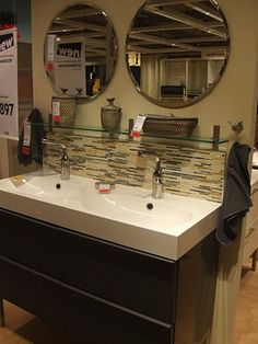 Because the sink won't have much counter space, put up a shelf above the faucets
