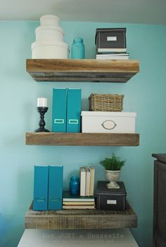 Floating shelves with hidden drawers... brilliant for entertainment center on larger scale