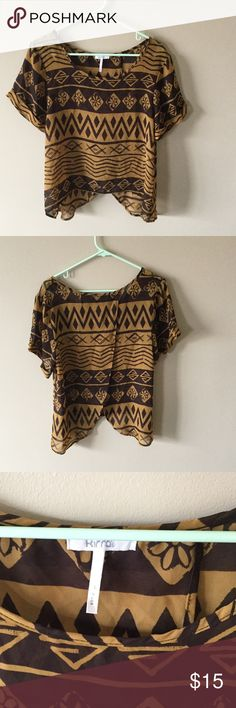 Kirra Aztec print shirt with an open flowy back Kirra top with an open back, two pieces of fabric fold over the other. Aztec style pattern, light and flowy and sheer. Size large, no damage Kirra Tops Blouses