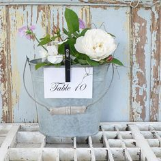 Galvanized buckets as centerpieces with table numbers clipped to them. Galvanized Buckets, Centerpieces, Table Decorations, Wine Design, Romantic Look, Here Comes The Bride, Table Numbers, Flower Pots, Wedding Inspiration