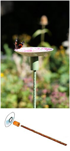 DIY Butterfly feeding place made of a saucer, a piece of a broom stick and a rebar.