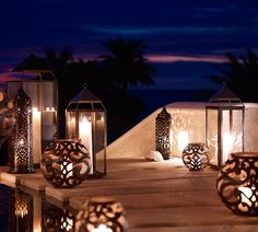 Light up your walkway with the glow of candlit lanterns this summer.