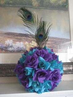 Peacock Centerpiece Pomander I'd like something like this to hang in some of the rooms and the back porch. Not really sure about the flowers though. Peacock Wedding Centerpieces, Wedding Decorations, Purple Centerpiece, Centrepiece Ideas, Blue Wedding, Wedding Colors, Dream Wedding, Wedding Flowers, Wedding Color Combinations