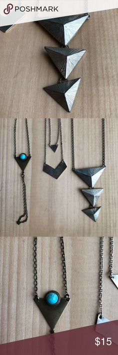 Geometric jewelry necklace bracelet hand jewelry An awesome selection of geometric / boho jewelry   1st: Hand jewelry handmade by an Etsy seller. Attached around your middle finger and wrist. Triangle charm with turquoise in center. NEW, never worn.  2nd: Shorter layered geometric shape necklace from Brandy Melville. Good condition, some wear as shown in picture.   3rd: Long three triangle necklace from Forever 21. Has a little fading/ wear as seen in pictures but hardly noticeable when on…