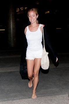 Kristin Cavallari Photos - NO GERMANY / SWITZERLAND.Kristin Cavallari and Jake Cutler arrive at LAX (Los Angeles International Airport) back from cabo. Kristin looks a little tan as the couple catch a taxi. - Kristin Cavallari and Jay Cutler at LAX