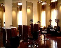 salon idea. Dark wood. Big mirrors