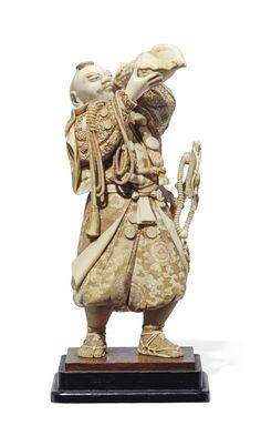 AN IVORY OKIMONO [SCULPTURAL ORNAMENT] -  SIGNED NOBUTAKA, MEIJI PERIOD (LATE 19TH CENTURY).
