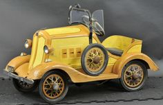 """HUPMOBILE PEDAL CAR American National, pressed steel, done in nicely detailed brown and yellow color scheme, features spare wheel on side, headlamps, windshield visor and front bumper, decal states """"Ball Bearing Gear Drive"""". 48"""" l. Original paint & stenciling, well preserved example of early 1930's toy auto."""