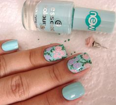 Beautiful pastel blue with floral detail nail art
