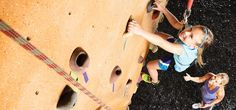 Set a healthy example for your kids by doing fun things as a family. Climbing walls are always a challenge!