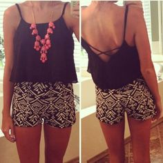 Black blouse, pink necklace and shorts for ladies