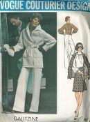 An original ca. 1974 Vogue Pattern 2987. Irene Galitzine - Misses' Jacket, Blouse, Skirt and Pants. Loose-fitting, lined wrapped jacket has bias collar, center back vent, patch pockets with turn-back flaps, self tie belt and back carrier holding in fullness at waitline; wrist length bias sleeves extending into front and back yoke are gathered into bias turn-back cuffs. Topstitch trim...