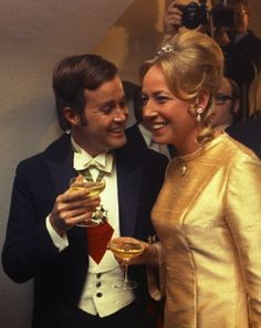 """Krupp inheritor, Arndt von Bohlen und Halbach, and his wife to be Henriette Princess of Auersperg with a glass of Champagne, at a reception they gave for friends and the press at the Hotel """"Goldener Hirsch"""" in Salzburg, Austria, 12 Feb 1969, two days before their wedding."""