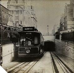 London, England: Tram emerging from the Kingsway Tunnel, circa 1920 1920 London, London Bus, Vintage London, London Life, Old London, London Street, London Pictures, London Photos, London Underground Train