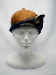 Felted hat with feathers