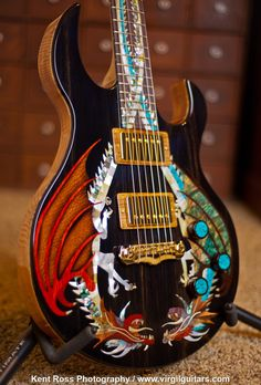 """This was the first guitar I ever built called """"The Dueling Dragons"""". I sold it in 2012 for $17,000.00 USD and it was featured in the Sept. 2013 issue of Guitar World. Visit www.virgilguitars.com for more details!"""
