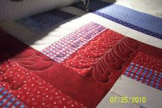 This is a rail fence that I quilted with feathers for a Quilt of Valor quilter.