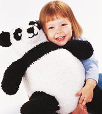 Giant Panda...  Giant Panda It may look difficult to make, but you can crochet, stuff, and assemble this 18-inch-tall bear as you work. From the magazine, Simply Creative Crochet 2003
