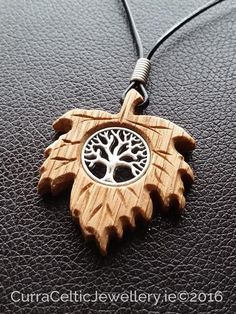 Tree of Life symbol (yggdrasil) in silver or bronze on Irish Oak with handmade … - wood working carving Dremel Wood Carving, Wood Carving Art, Bone Carving, Wood Art, Wood Carving Designs, Wood Carving Patterns, Wooden Jewelry, Resin Jewelry, Handmade Jewelry